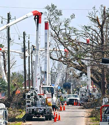 volt crews in bucket trucks responding after a major hurricane event